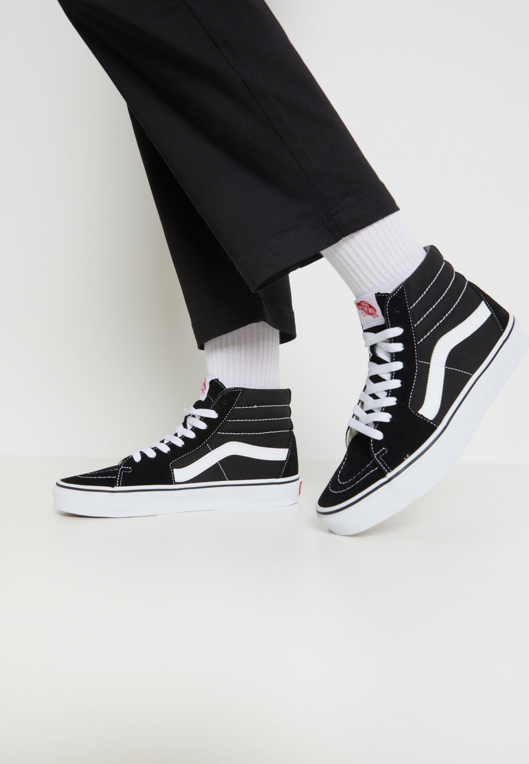svarta höga sneakers