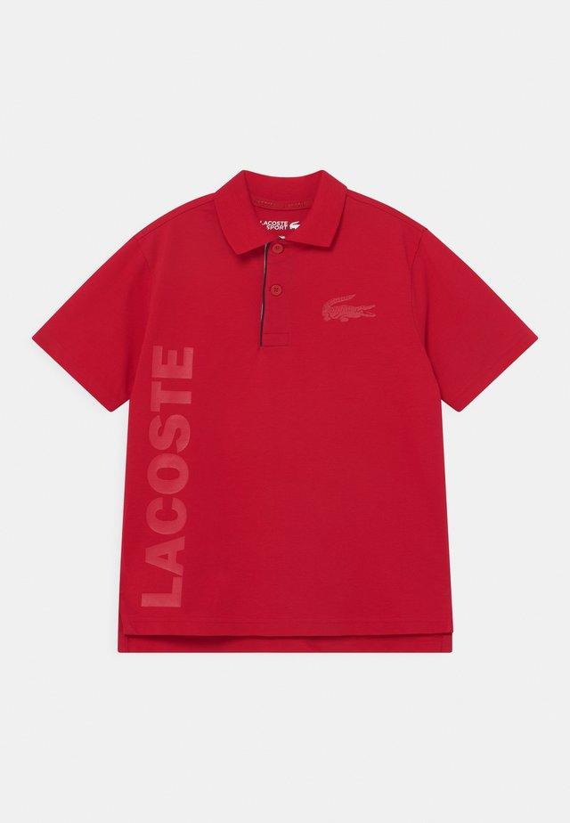 UNISEX - Poloshirt - ruby
