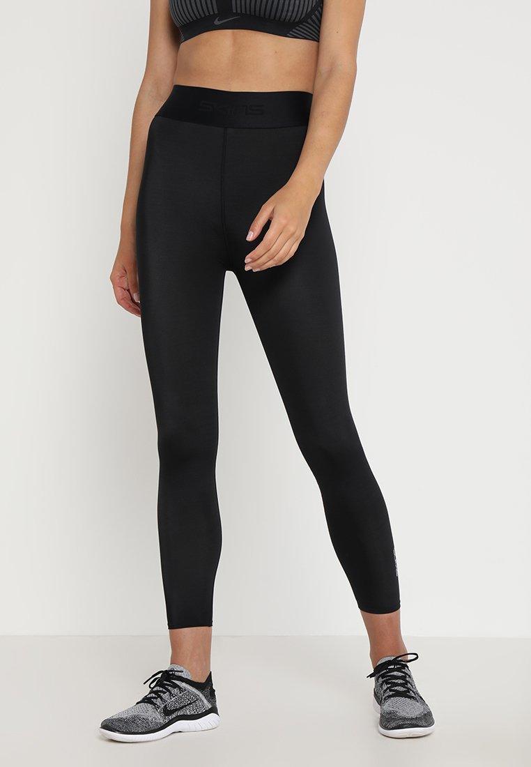 Skins - DNAMIC PRIMARY SKY - Leggings - black