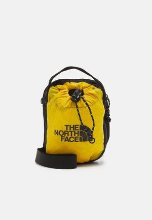 BOZER CROSS BODY UNISEX - Across body bag - arrowwood yellow/black