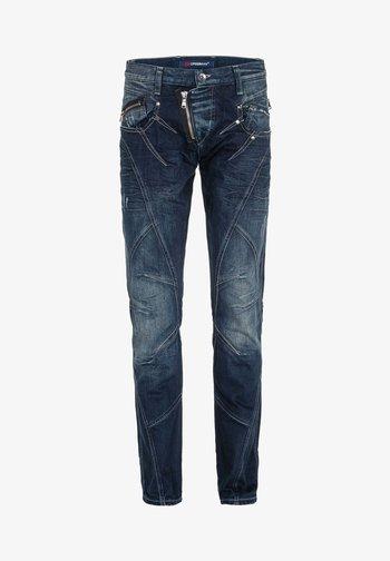 MIT ZIERNÄHTEN UND REISSVERSCHLÜSSEN - Straight leg jeans - donkerblauw