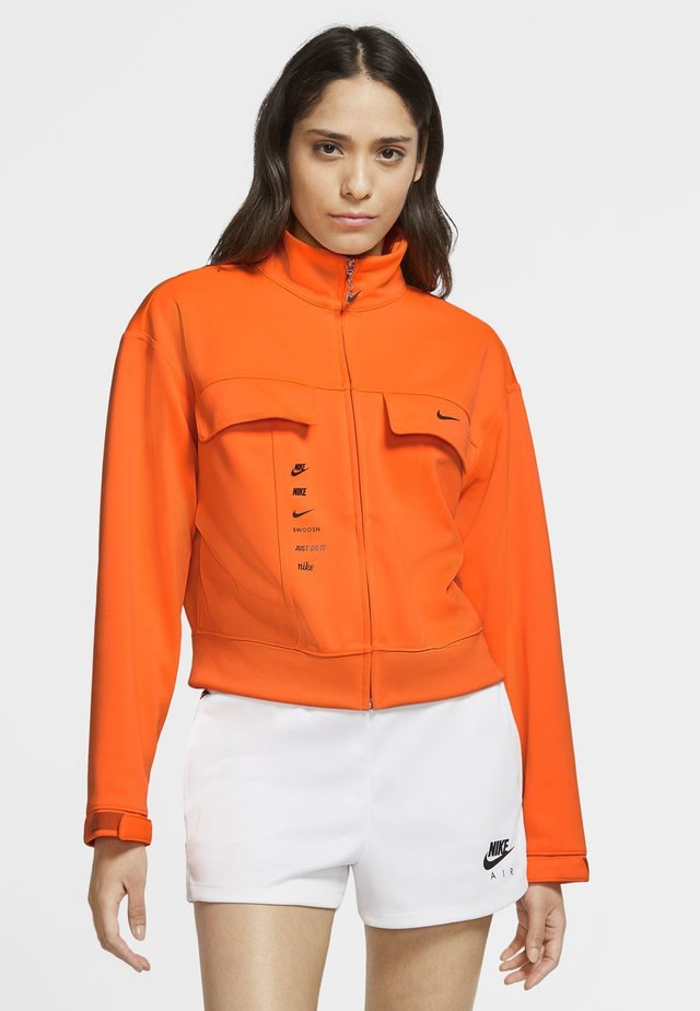 Training jacket - total orange/firewood orange/black