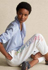 Polo Ralph Lauren - SEASONAL - Tracksuit bottoms - white - 3