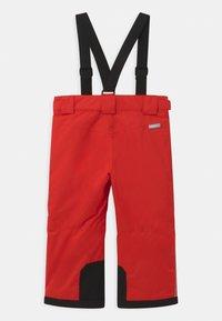 Reima - WINTER TAKEOFF UNISEX - Zimní kalhoty - tomato red - 1