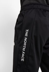 The North Face - LOGO JOGGER - Verryttelyhousut - black - 5