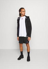 Tommy Hilfiger - LOGO FLAG SHORT - Sports shorts - black - 1