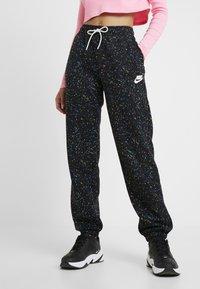 Nike Sportswear - Tracksuit bottoms - black/white - 0
