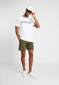 Calvin Klein Performance - SHORT - Sports shorts - green - 1