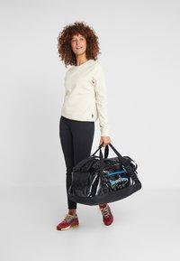 Patagonia - BLACK HOLE DUFFEL 55L UNISEX - Sports bag - black - 7