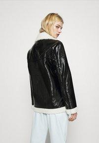 NA-KD - SHINY AVIATOR JACKET - Winter jacket - black/white - 2