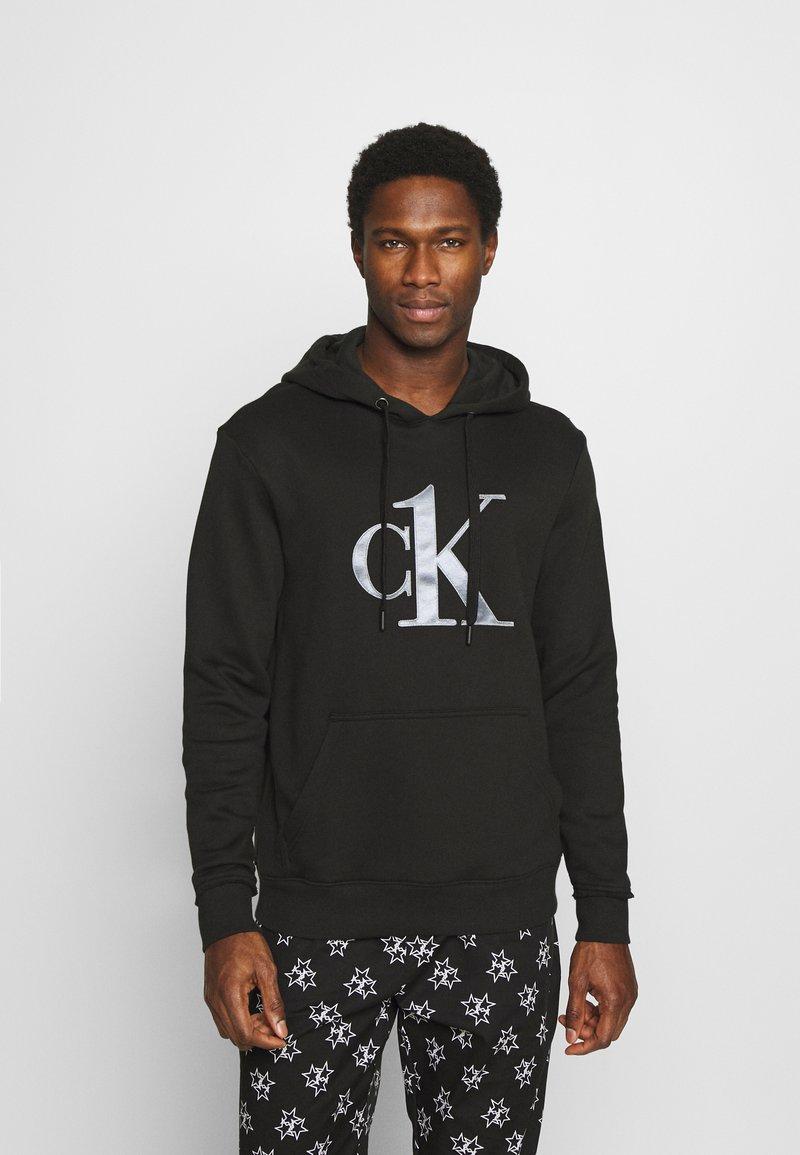 Calvin Klein Underwear - ONE RAW EDGE HOODIE - Pyjama top - black