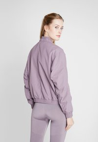 adidas Performance - BOMBER - Training jacket - purple - 2