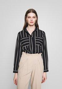 ONLY - ONLFREYA  - Button-down blouse - black/cloud dancer - 0