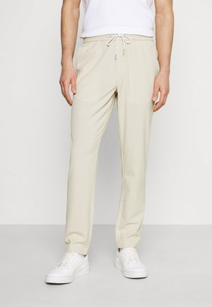 WITH DRAWSTRING - Trousers - sand