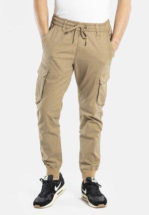 REFLEX RIB CARGO - Cargo trousers - dark sand