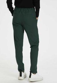Kaffe - NANCI JILLIAN - Trousers - dark green - 2