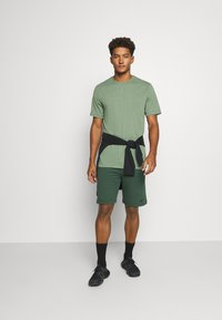 Nike Performance - DRY SHORT - Sports shorts - galactic jade - 1
