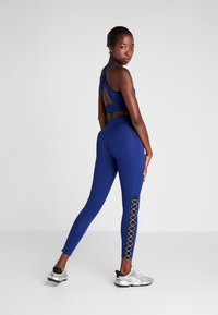 Puma - PAMELA  REIF X PUMA HIGH WAIST LACE UP LEGGINGS - Legginsy - blue depths - 2