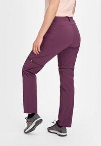 Mammut - RUNBOLD ZIP OFF WOMEN - Outdoor trousers - blackberry - 1