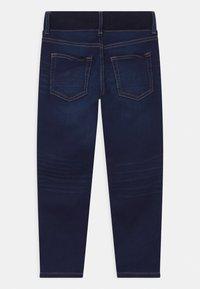 Lindex - MINI EDVIN PULL ON - Slim fit jeans - dark denim - 1