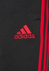 adidas Performance - Träningsbyxor - black/scarlet - 5