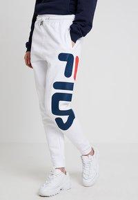 Fila - PURE BASIC PANTS - Trainingsbroek - bright white - 0