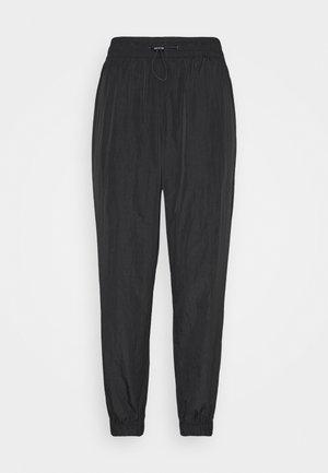 JOGGER - Pantalones deportivos - black