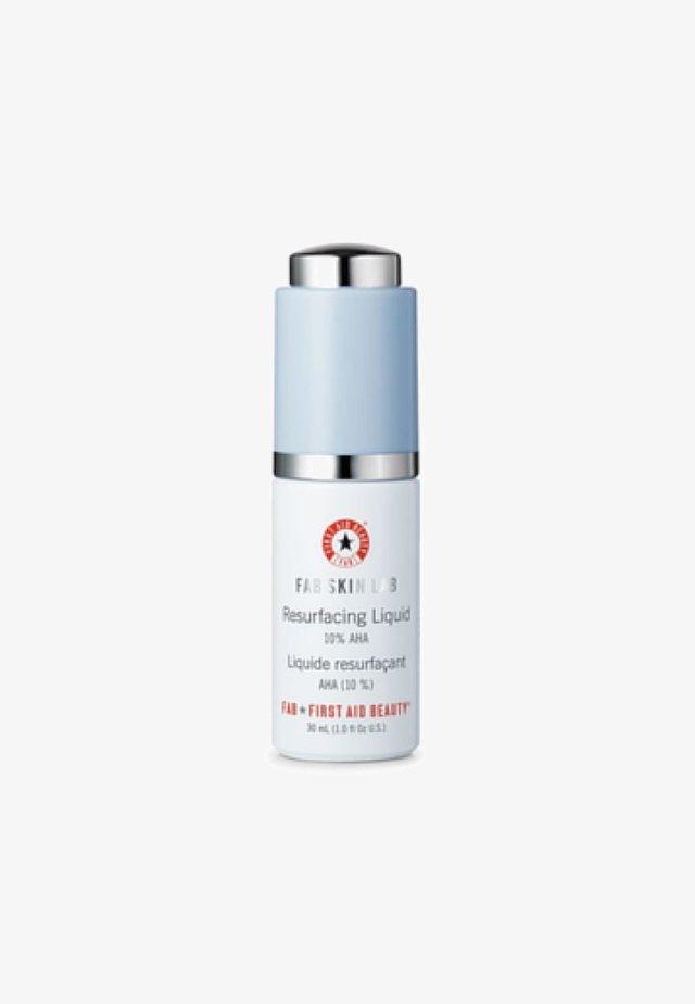 FIRST AID BEAUTY SKIN LAB RESURFACING LIQUID 10% AHA - Face scrub - transparent
