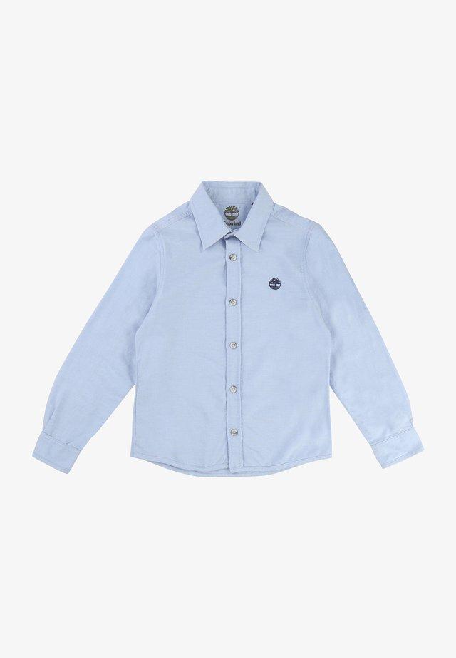 Chemise - bleu clair