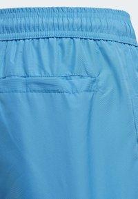 adidas Performance - BADGE OF SPORT PRIMEGREEN REGULAR SWIM SHORTS - Swimming shorts - blue - 2
