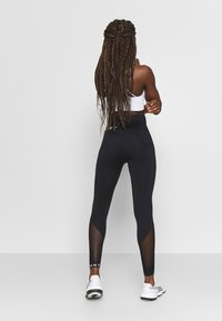DKNY - HIGH WAISTED SEAMLESS - Leggings - black - 2