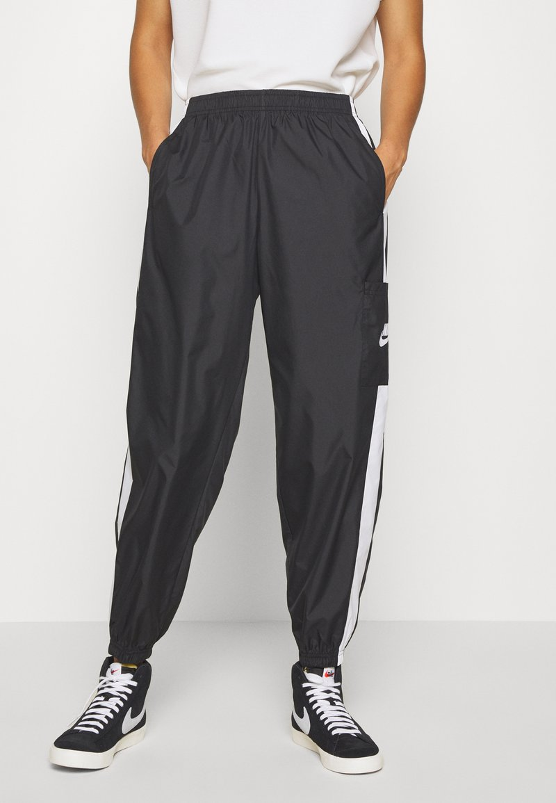 Nike Sportswear - PANT  - Tracksuit bottoms - black/white