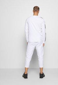Kappa - HAIMO LONGSLEEVE - Long sleeved top - bright white - 2