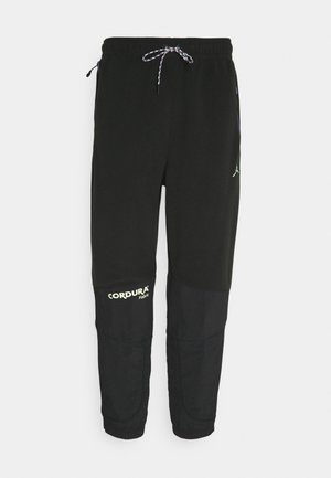 MOUNTAINSIDE PANT - Tracksuit bottoms - black/court purple/barely volt