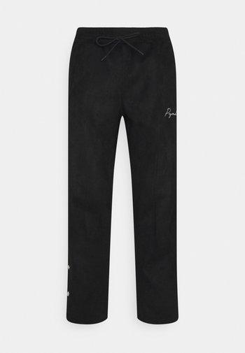 SUEDE BUTTON PANTS UNISEX - Trousers - black