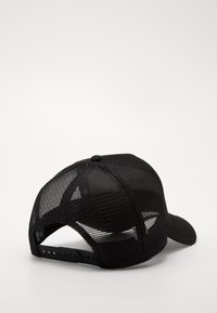New Era - DESTINATION TRUCKER - Lippalakki - black/ white