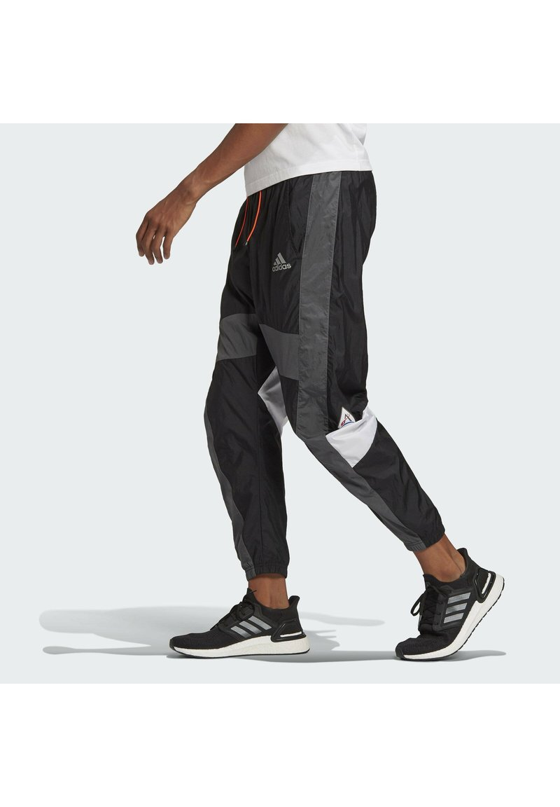 adidas Performance - Tracksuit bottoms - black/black