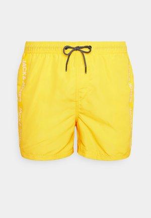 JJIBALI JJSWIMSHORTS LOGO TAPE - Swimming shorts - vibrant yellow