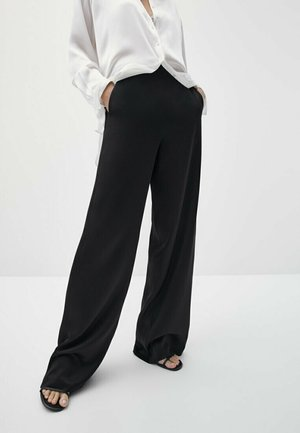 FLIESSENDE SATINIERTE  - Trousers - black