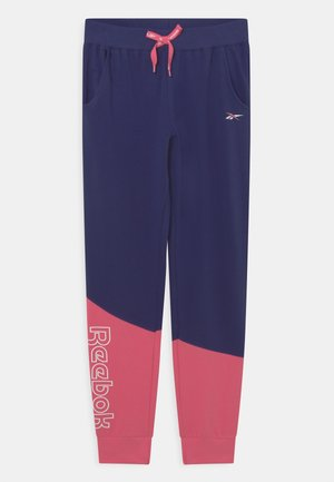 DIAGONAL - Tracksuit bottoms - navy/coral