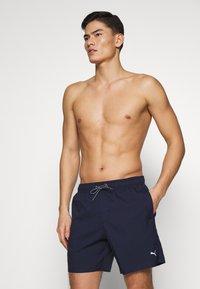 Puma - SWIM MEN MEDIUM LENGTH - Swimming shorts - navy - 1