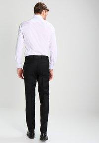 Tommy Hilfiger Tailored - RHAMES - Oblekové kalhoty - black - 2