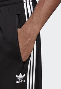 adidas Originals - FIREBIRD ADICOLOR TRACK PANTS - Tracksuit bottoms - black - 3