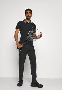 adidas Performance - TENNIS PANT - Verryttelyhousut - black/grey - 3