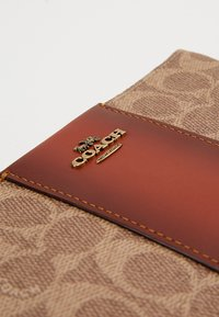 Coach - COATED SMALL WRISTLET - Wallet - tan rust - 3