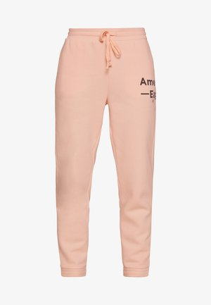 GRAPHIC JOGGER - Tracksuit bottoms - peach