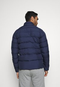 Puma - WARMCELL LIGHTWEIGHT JACKET - Winter jacket - peacoat - 2