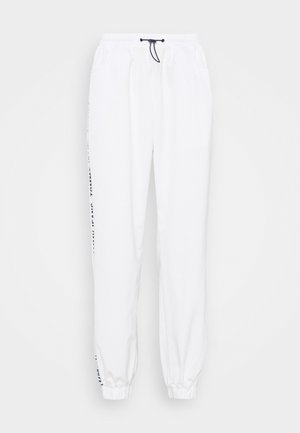 TAPE RELAXED - Tracksuit bottoms - white