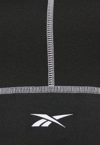 Reebok - WOR DETAIL BRALETTE - Sport-BH mit leichter Stützkraft - black - 6