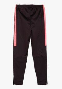 Nike Performance - ACADEMY WINTERIZED - Tracksuit bottoms - burgundy ash/racer pink/reflective silv - 1